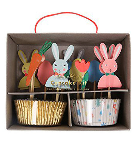 Kit with gold and silver cupcake holders with bunnies and paper carrots for decorations.