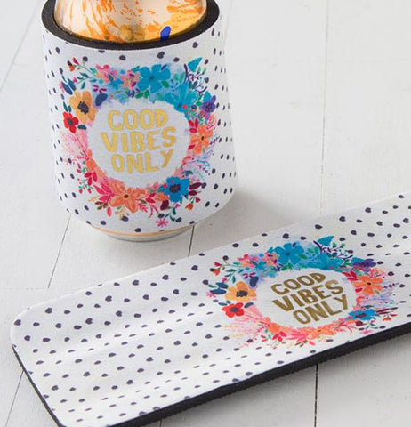 "The cup holder with the flower design and the words, ""Good Vibes Only"" is shown wrapped around a soda can. Another is shown lying on a table."
