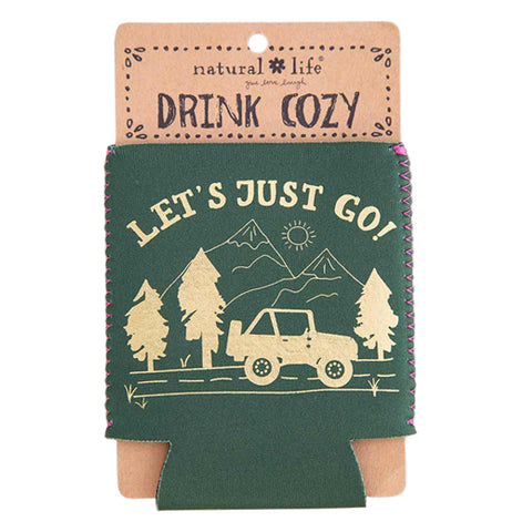 "This green drink cover is shown in its brown cardboard packaging. The cover has a design of a car driving through mountains. Above the mountains, in yellow lettering, are the words, ""Let's Just Go""."