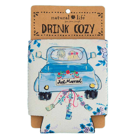 "This packaged white drink cozy has a picture of a man and woman driving away in a blue pickup truck with the words, ""Just Married"" on the back."