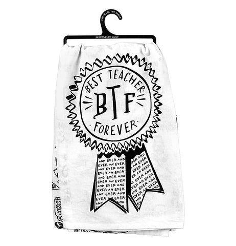 "A white Dish Towel that has a black outline of an award ribbon with the words ""Best Teacher Forever"" printed inside in black text."
