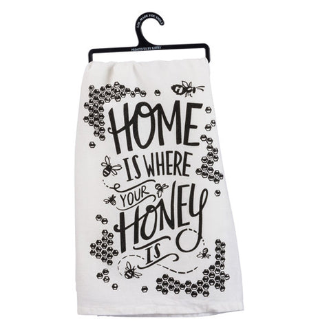A white cotton dishtowel. Honeycombs and bees frame the edge.