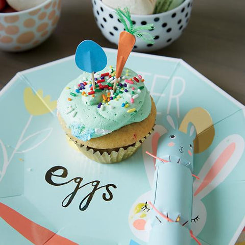 Light blue plate with a cupcake with the decorations featured.