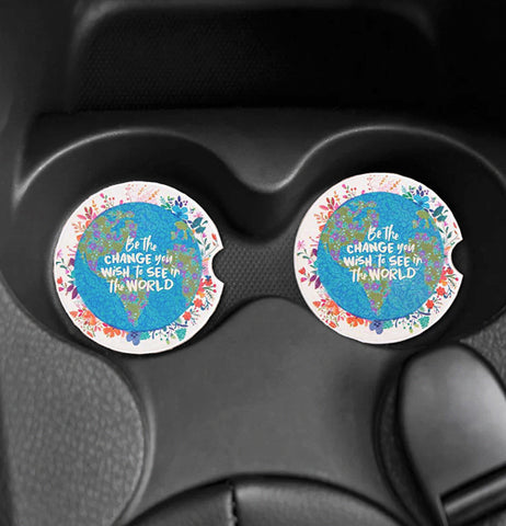 "The ""Be The Change"" Car Coasters fits in both cup holders of the car."
