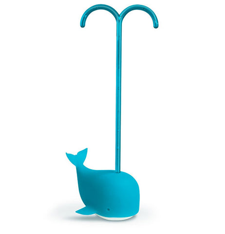 A blue whale tea infuser with its handle attached spewing water out of its mouth.