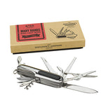 Penknife multi-tool with its tools displayed laying next to its tan box.