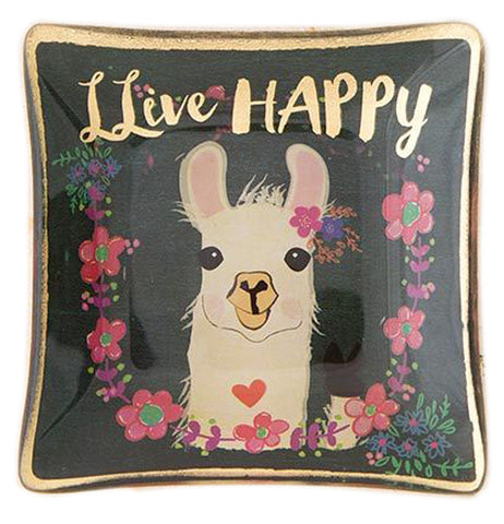 "This small black glass tray features a llama design in the middle surrounded by a few pink flowers. At the top, above the llama's ears, are the words, ""LLive Happy"" in white lettering."