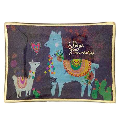 "This dark purple glass tray with a gold lining has a picture of a small white llama and a larger blue llama with a heart between them. Both llamas are standing next to cactus and have colorful rugs covering their backs. Above the blue llama are the words, ""I Love You Momma"" in yellow lettering."