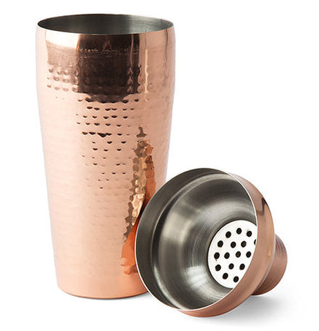 "The ""Hammered Copper"" cocktail shaker is shown with its measuring cap taken off."