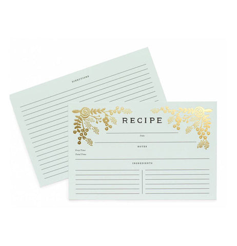 This is a light green recipe card that has gold florets on the top corners and has lined section so you can write on it.