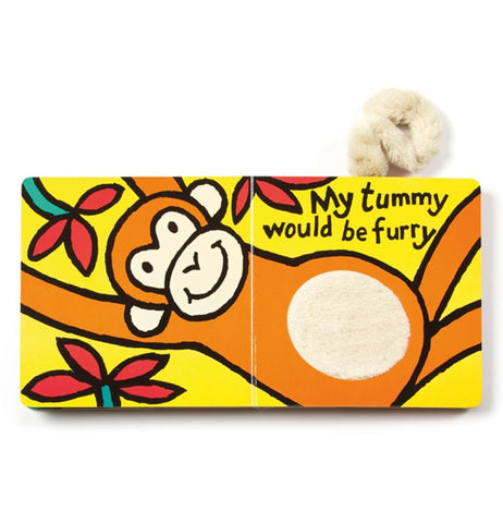 "The book is shown open to two pages showing an orange monkey with a fur textured belly laying with some flowers and the words ""My tummy would be furry"" in black lettering."