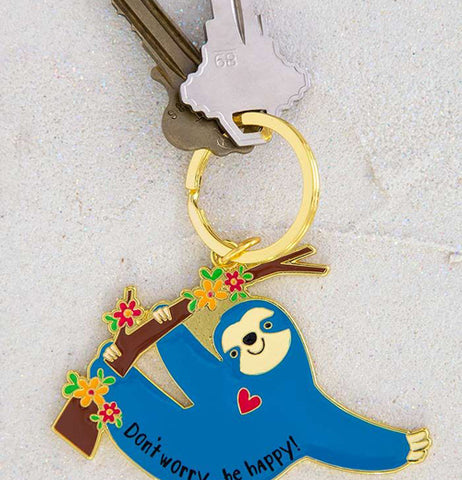 The sloth keychain is shown attached to two keys.