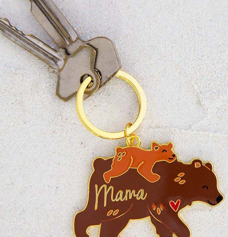 The Mama bear keychain is shown attached to two keys.