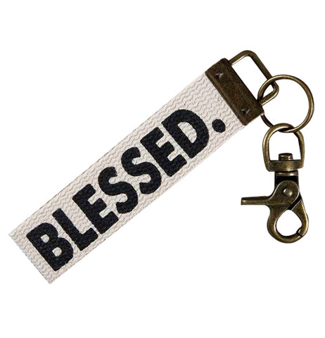 "This key fob has a small white banner with the word, ""Blessed"" written in black lettering across it."