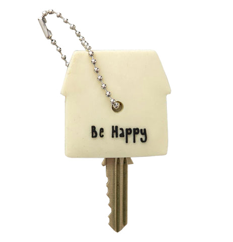 "This white House key Cap with black writing that says ""Be Happy"""