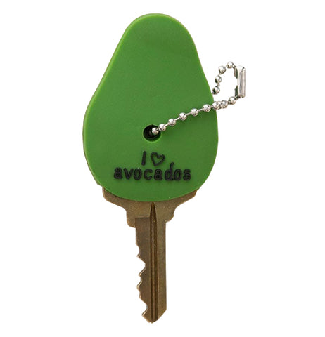 "This green ""I Love avocados"" key cap on a house key is green and looks like an an Avocado with text that says ""I love avocados.""."