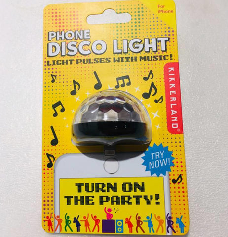 "The iPhone disco ball light is shown inside its yellow packaging with the words, ""Phone Disco Light"" at the top in white lettering. Below that are the words, ""Light Pulses with Music"" in black lettering. The Kikkerland logo is shown to the right side of the box."
