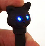 Black LED cat pen with the eyeys of the cat head lit up.