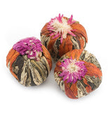 Pictured is three lavender sorbet green tea bulbs that will flower and release the tea when bloomed in hot water.