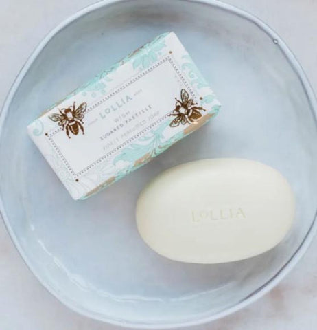 Lollia sugared pastilled soap with shea butter with light blue and gold with bee's on it out of the packaging