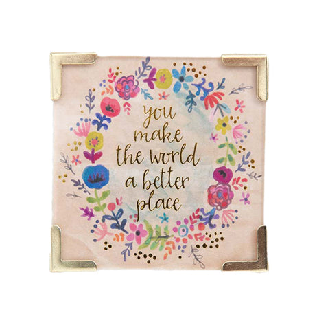 "A pink magnet with the words ""You Make The World a Better Place"" in Gold Foil Words with a Floral Design."