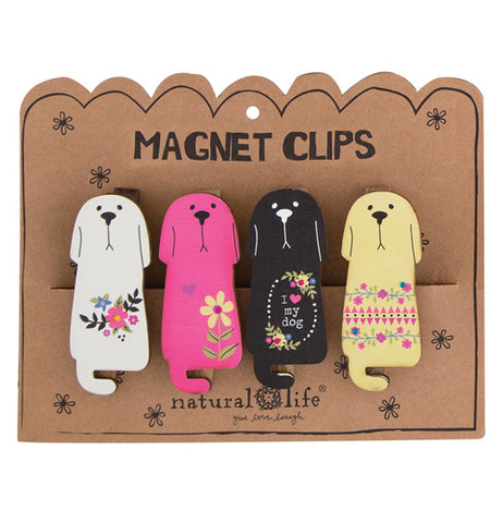 White, pink, black, and tan dog magnet clips in it's packaging.
