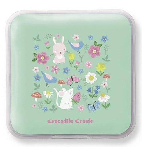 "This teal green ice pack features pink, white, blue, and yellow flowers with a few red mushrooms, a pink rabbit, a blue bird, and a white mouse on its front. At the bottom of the pack is the logo, ""Crocodile Creek"" in pink lettering."