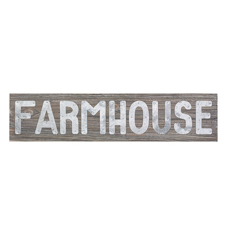 "Rectangular wooden sign with silver metal letters spelling the word ""Farmhouse."""