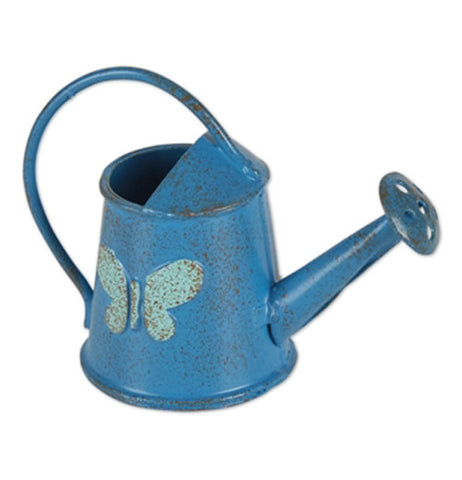 Mini blue watering can with a butterfly on the side.
