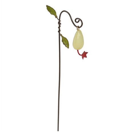 This garden pick shows a teardrop shaped gem with a flower coming from the bottom, its attached to a metal pick at the top which loops around and makes a swirl and has two leafs attached near the top as well.