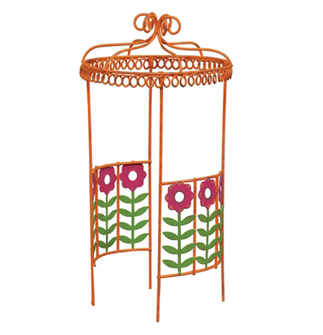 Mini metal orange Gazebo with pink flowers and green stems on two sides near the bottom of it.