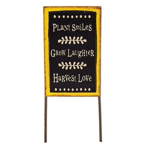 "The ""Plant Smiles"" mini sign has the quote that says, ""Plant smiles, grow laughter, harvest love"" on it stands alone."