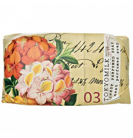 Tan mini soap with a large pink flower on it.