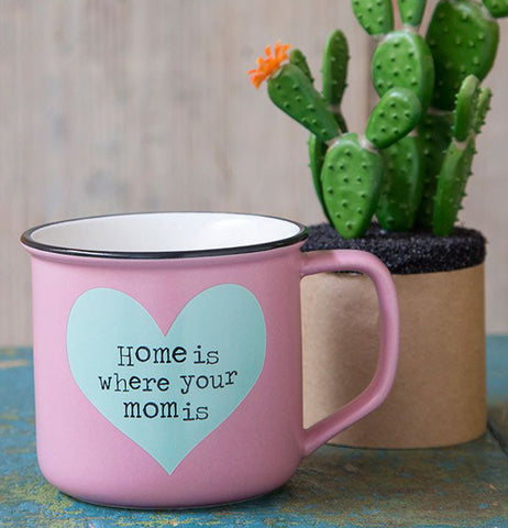 "The ""Heart"" Camp Mug sits well next to the pot of cactus."