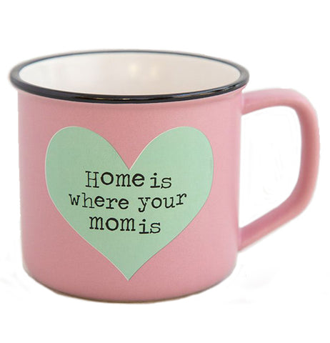 "The ""Heart Camp Mug has a pink background with a blue heart shape and a message that says, ""Home is Where Your Mom is""."