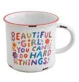 "The ""Beautiful Girl"" Camp Mug has colorful letters along with floral designs that says, ""Beautiful Girls You Can Do Hard Things""."