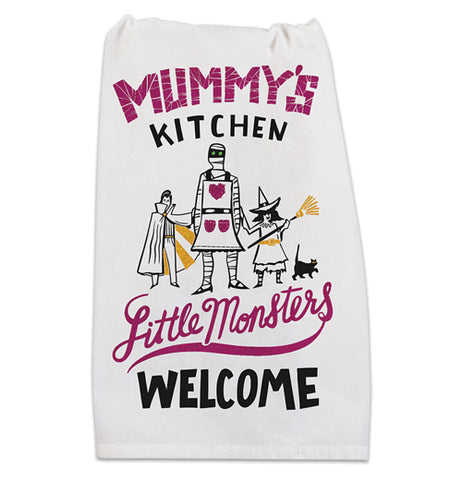 A white towel with the phrase mummy's kitchen featuring a little witch, a young vampire, and a mummy