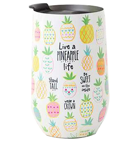 "This close-up picture of a ""Live a Pineapple Life"" Water Tumbler with decorative colors of yellow, pink, and green pineapples, and a black spill-proof lid."