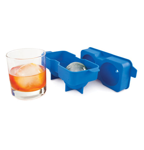 Blue ice tray that is balloon shaped open with a glass of liquid and an ice cube.
