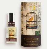The perfume Song in D Minor no 13 is alongside a box with a birdcage with the saying Tokyomilk, Eau de parfum song in d minor printed on it
