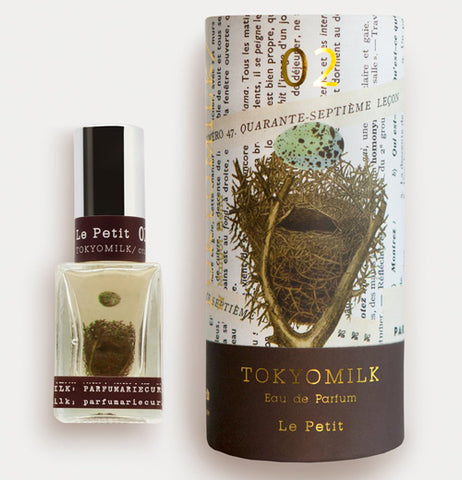 This perfume has a birds nest with an egg falling in the nest alongside its box that shows the same picture and says TOKYOMILK