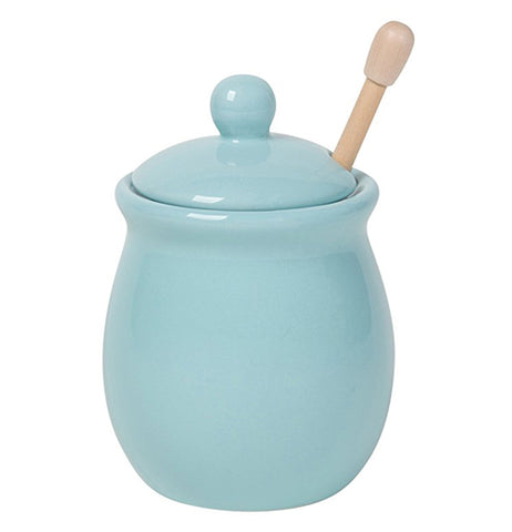 Baby blue honey pot with lid and honey dipper inside.