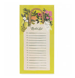Yellow and white market pad with a design that looks like a shopping bag with fruit and flowers on a white background.
