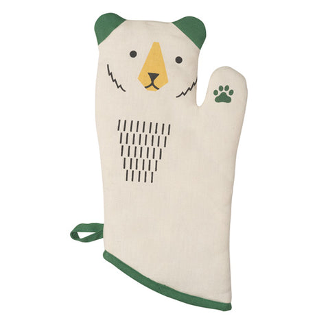 A white bear shaped oven mitt with green ears and a yellow nose