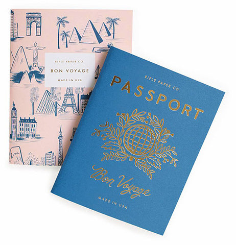 "This passport has gold and blue designs, global sphere and under the title it says ""Bon Voygage""."