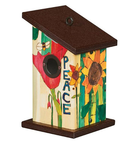 Front view of Peace Everywhere birdhouse with Peace written in green next to a red tulip with black opening for birds. An orange sunflower with green stalk decorates the side. The base and roof are brown on this birdhouse.