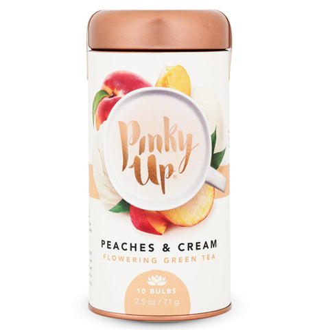 "This jar with a copper colored lid depicts a mug full of tea with the words, ""Pinky Up"" in copper lettering. The cup is surrounded by red and orange peaches. Below the picture are the words, ""Peaches & Cream"" in black lettering. Beneath the black letters are the words, ""Flowering Green Tea"" in copper lettering, and down at the bottom of the jar is a copper circle with a white picture of a flower. Beneath the flower are the words, ""10 bulbs. 2.5 oz and 71 grams"" in white lettering."