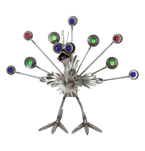 This metal sculpture is shaped like a small peacock with red, green, and blue marbles for its tail feathers.