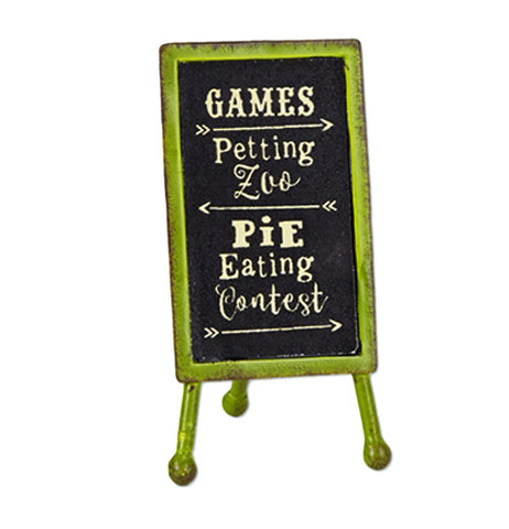 "This sign has an eventuality that is green with a black chalkboard. The words, ""Games, Petting Zoo, Pie Eating Contest"" are all spelled out across the blackboard in white lettering."