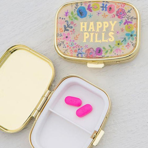 "Two ""Happy Pill"" boxes are shown. One is shown closed, and the other is shown open with two small pink pills."